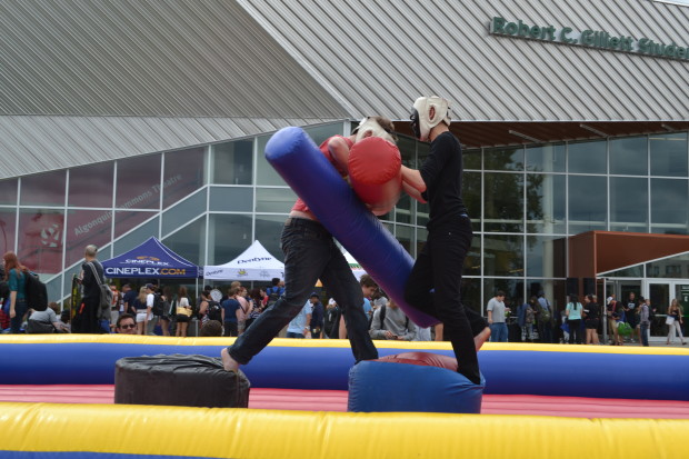 Two students fight with padded gear in the gladiator pit at the Student Association's carnival. This is the fourth year the SA has held the event.
