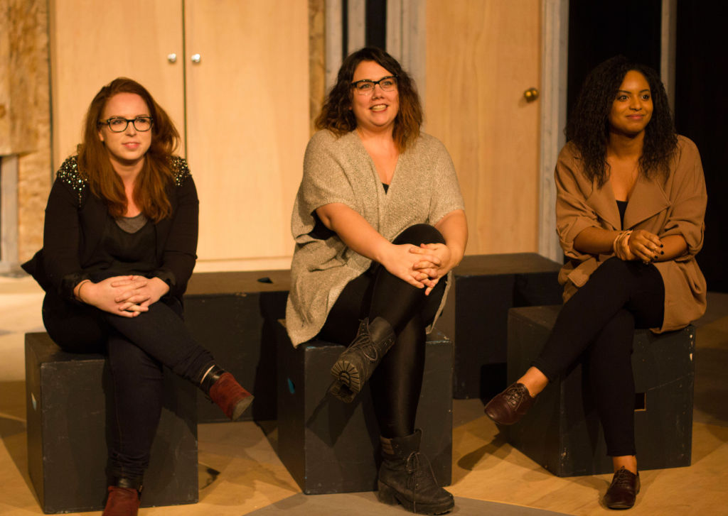 Scriptwriting students Deborah Ring, Emma Conrad, and Bianca Perry answer questions from the audience after presenting their fresh plays at the reading. The event was held on Feb. 1 at the studio theatre.