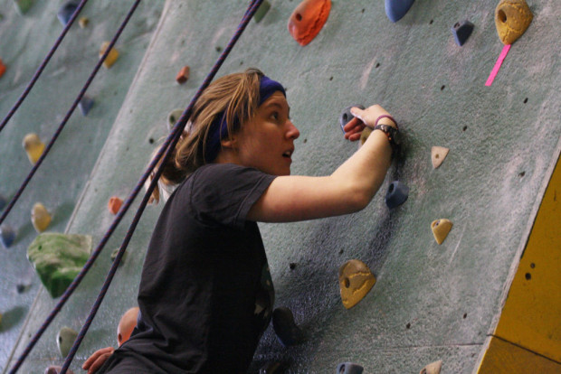 Bouldering entails scaling walls without being roped in. Alison MacKay, a second-year paramedic student is more experienced than most of the students at the rock climbing event on March 19 in the Coyote Rock Gym.