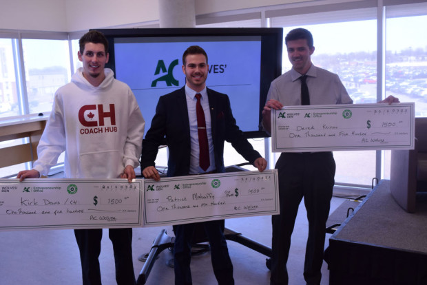 Kirk Davis, Patrick Mahaffy and Derek Kernan hold cheques for $1,500. They won the AC Wolves' Den competition, a Drgoan's Den-style innovation competition, which was held in the AC Hub on March 23.