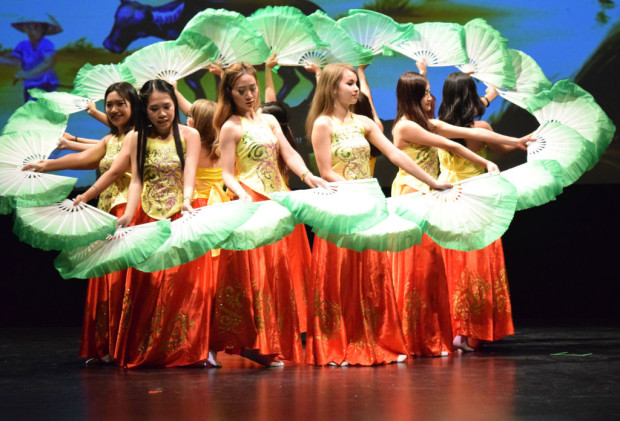 Twelve dancers form into the shape of a giant lotus leaf at the Spring Gala on Feb. 20. Fan dancing is one of the traditional performances held within the Lunar New Year celebration.