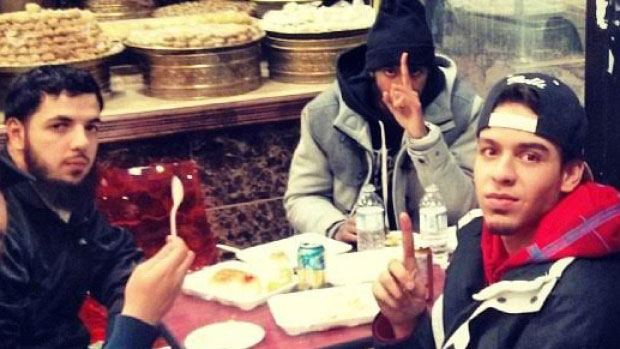 (Instagram Photo) From left, former students Awso Peshdary, alleged terrorism suspect, Khadar Khalib, believed to have joined ISIS to fight in Syria and Ayyub Arab, former MSA secretary at a restaurant in 2014. They are raising one finger, in the photo, a hand gesture that is often used in ISIS propaganda films.