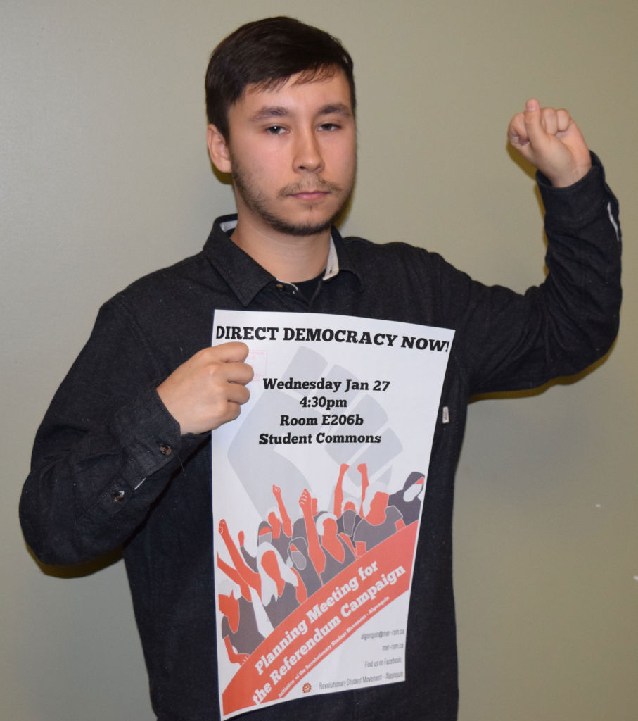 Brendan Copegog White, co-founder of RSM, with their campaign poster. They are planning to hold a major campaign on Jan. 7.