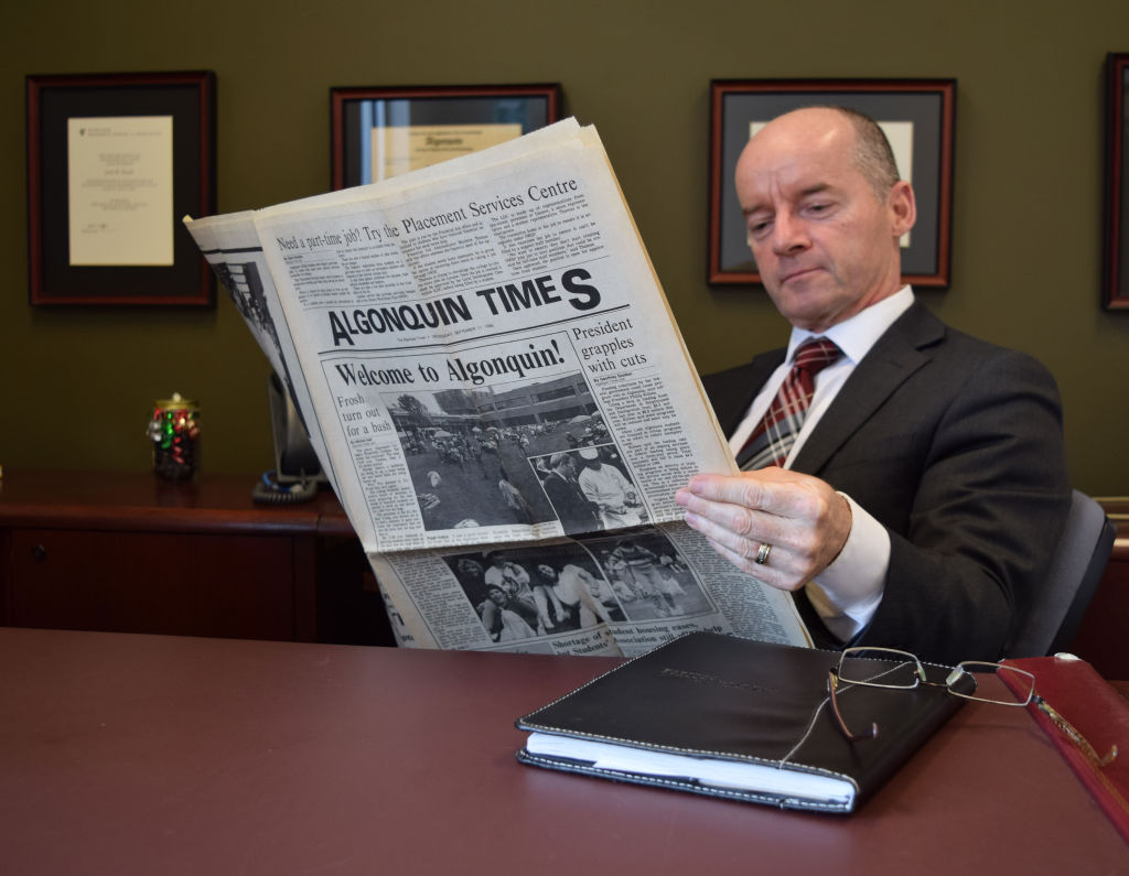 General manager of the SA Jack Doyle leafs through the first edition of the Times. Doyle is a grad from the business administration program and had just started at the college when the paper was first published.