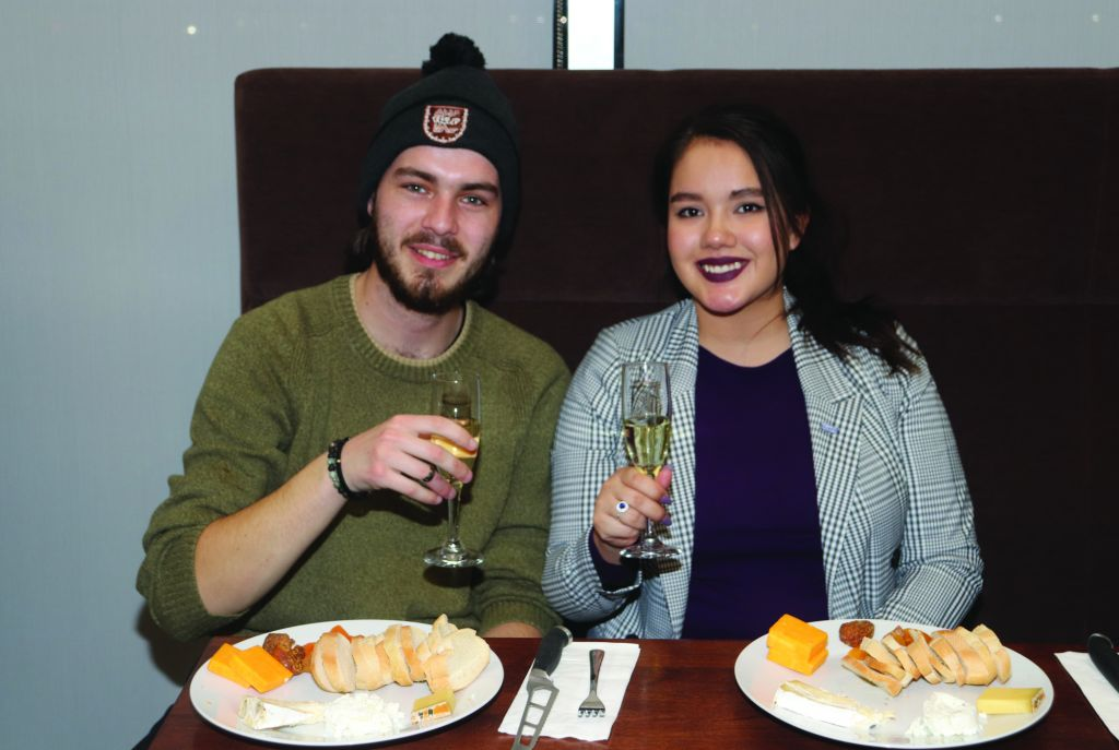 Joshua Hall and Allison MacLeod, aboriginal studies students at Algonquin College, enjoy an evening of wine and cheese pairings together.