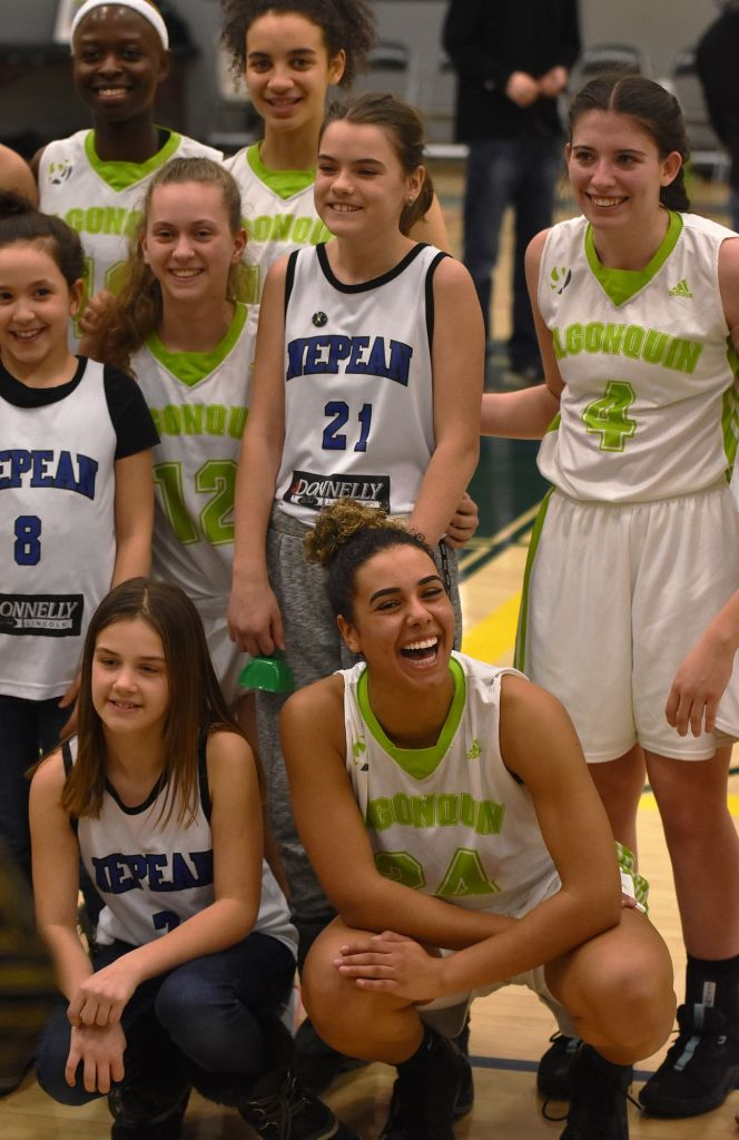 Rita Sibo, Meaghan McNamara, Nyla Sabourin, Alyx Caesar and Michaela Branker joined a young girls basketball team from Nepean that were there to cheer them on at the seniors' game on Fri. Feb. 21.