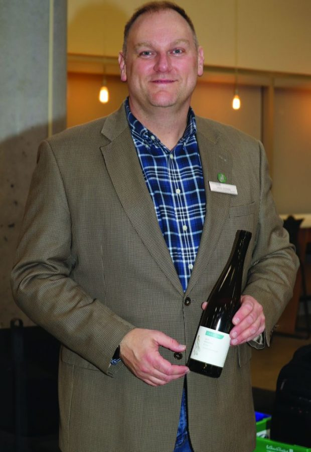 Gregory Nyman, sommelier instructor at Algonquin College, showcases a bottle offered in the pairing event.