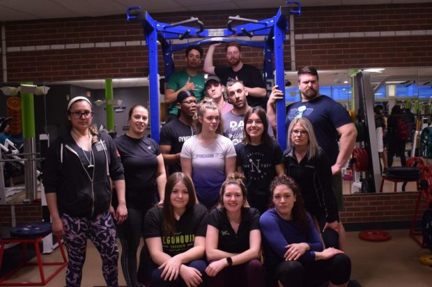 Participants and staff of the Fitness zone's 2020 squat competition celebrate another another successful powerlifting event.