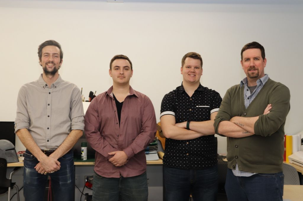 Civil engineering technology students Stefan Pecile, Cam Huxter, Chance Hainer and Derek Risk in the Makerspace lab.