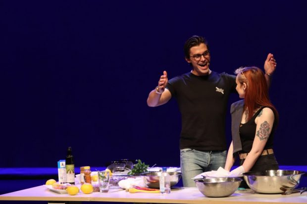 Porowski keeps a cooking demo light hearted with student guest Midg McKee.
