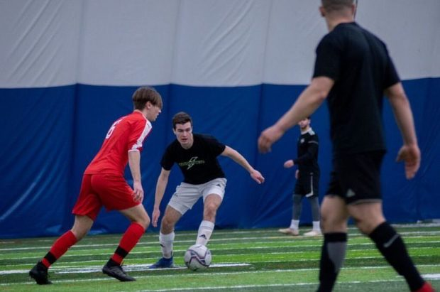 Nicolas Bisaillon, center, training in an indoor soccer dome
