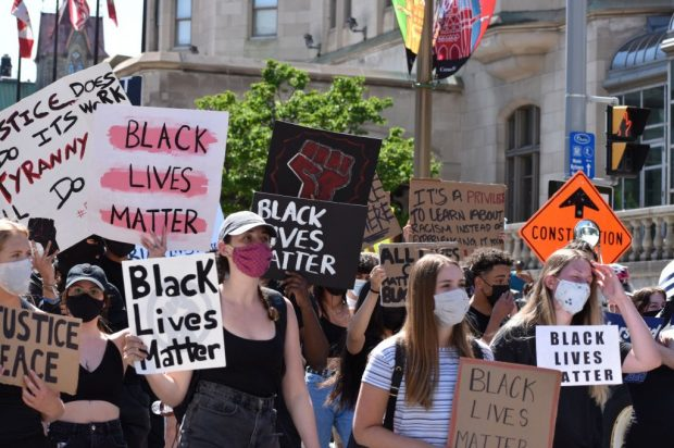 Black lives matter supporters stand in unison