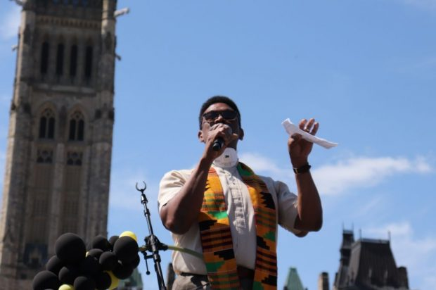 Rev. Anthony Bailey delivers a passionate speech addressing the prevalence of systemic racism in Canada.