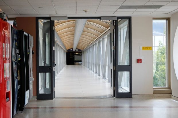 An empty corridor leading into the once bustling C Building