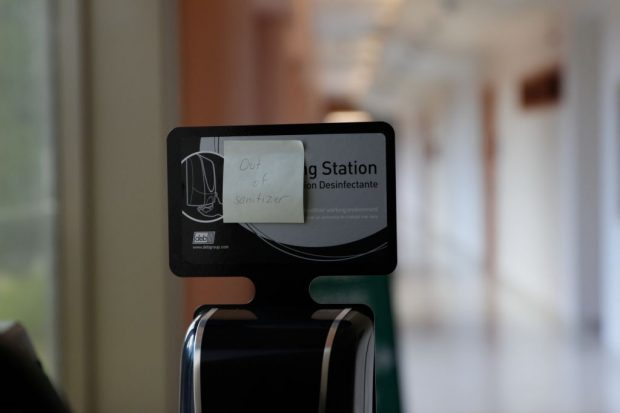 A hand-sanitization station in need of a refill