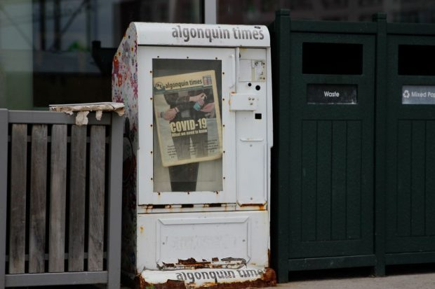 An old newspaper box with the last print edition of the Algonquin Times, published March 13, 2020, just before the the school was shut down