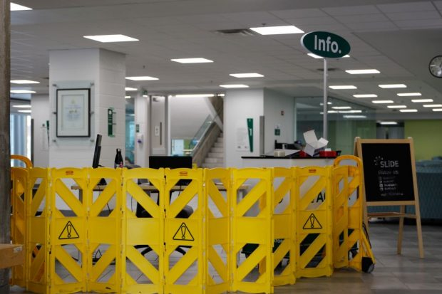 A new security table and partition guards one of the only entrances to campus