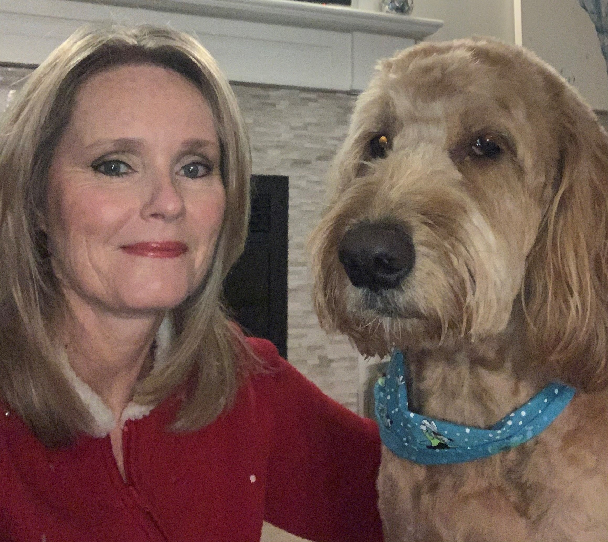 Tracy McDougall and Monte, golden doodle, are working from home and keeping in touch with students trough virtual meetings.