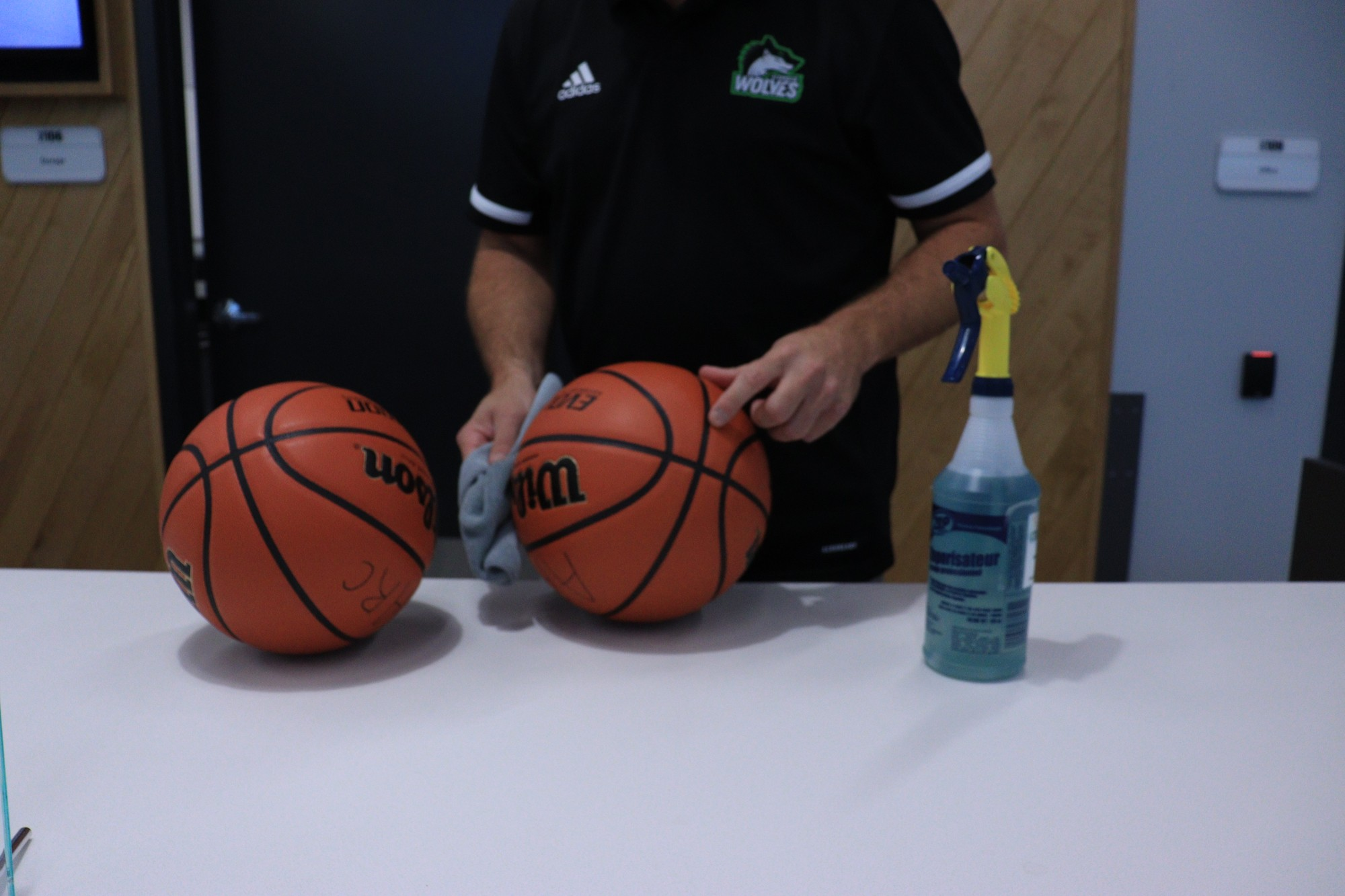 Athletics and recreation centre staff member, Mike Ciolfi sanitizing the basketballs between each use to ensure COVID-19 protocols are being followed.