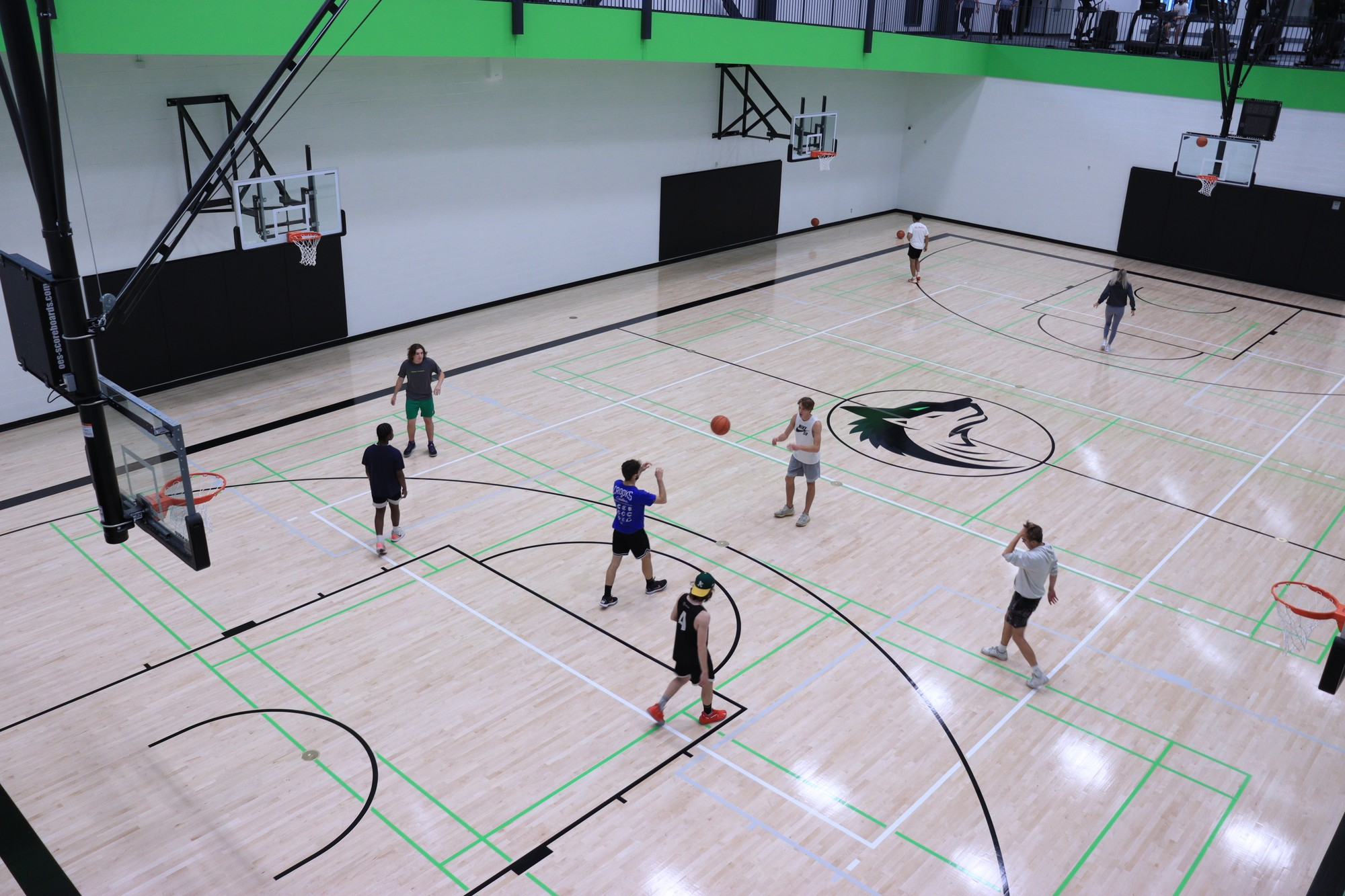 A group of college boys enjoying a fun game of basketball on one of the two fresh and new basketball court.
