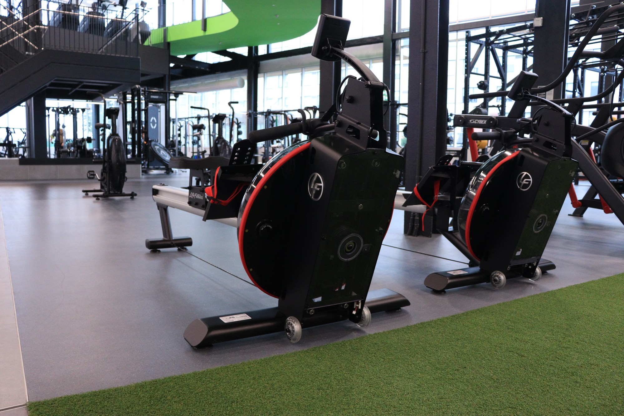 Rows upon rows of equipment such as elliptical machines that are provided by Hammer Strength and Life Fitness.