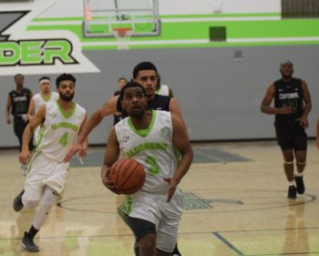 Men's basketball team claim victory over Centennial Colts